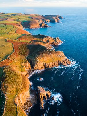 Lands End in Cornwall taken from a drone at sunset. This image is availabe as a print on canvas, fine art, aluminium and acrylic.