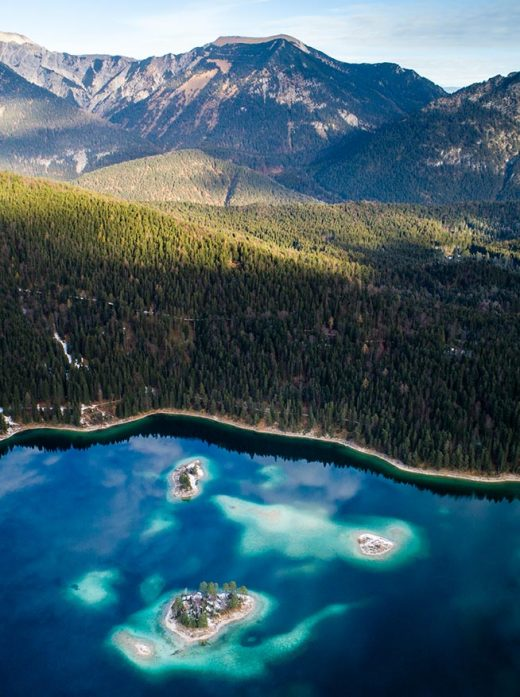 An aerial image take above the the islands of Lake Eibsee in Bavaria Germany.