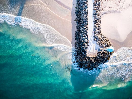 A Drone photo looking down on the city beach jetty in Perth western Australia at sunrise