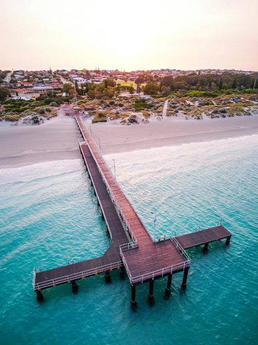 A Drone photo looking coogee beach jetty in fremantle Perth western Australia at sunrise