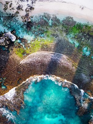An aerial drone photo looking at trigg Beach Reef in stirling Perth western Australia at sunrise