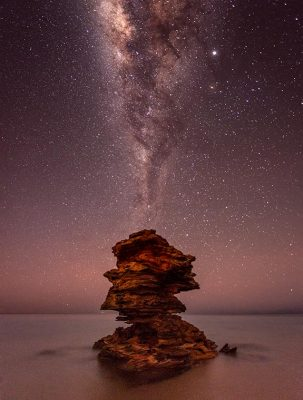 An Astro Photograph of the Milky Way captured above a rock stack at Entrance Point in Broome, Western Australia