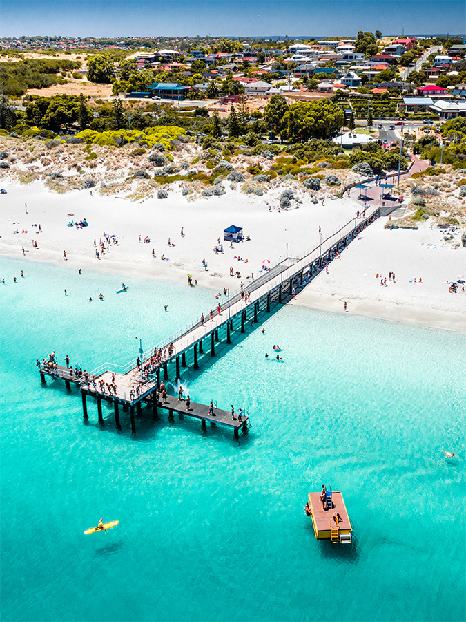 An aerial drone photo of coogee beach jetty during summer in Perth, Western Australia